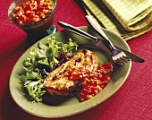 Pork steak with tomato sauce and green salad