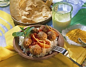 Indian meat balls with tomato & orange sauce on rice