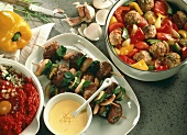 Mince kebabs with sauce, meatballs with peppers