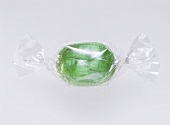 A green sweet in transparent wrapper