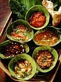 Thai sauces in banana leaf bowls