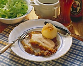 Two slices of roast pork with crackling with gravy & dumpling