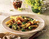 Rigatoni with broccoli & salami slices on plate