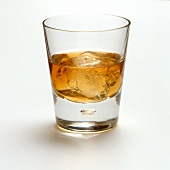 Whisky with ice cubes in glass