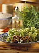 Pork fillet with ginger & sesame sauce & salad on plate
