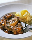 Ossobuco (Veal shank with ribbon pasta, Italy)