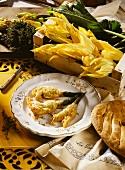 Stuffed, fried courgette flowers, decor: fresh flowers, bread