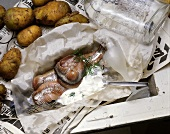 .Matjes(Smoked Herring) with Cream Sauce on a Paper