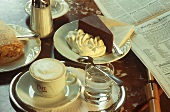 Coffee, water glass, Sacher torte & strudel on coffee house table