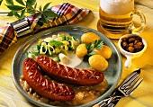 Polish sausages on raisin sauce with potatoes and leeks