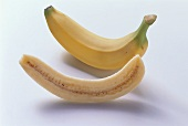 Whole banana and banana cut in half lengthways