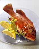 A Red Mullet Garnished with Lemons