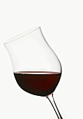 Glass of red wine from Cahors, France (dark-red colour)
