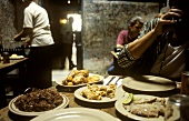 Cuban dishes on tables of a restaurant in Havana