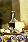 French goat's cheeses and red wine on table