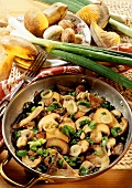 Mixed forest mushroom stir-fry with spring onions