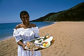 A Woman Holding a Platter of Seafood