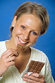 A Woman Eating a Chocolate Bar