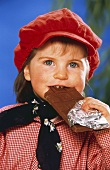 Young Girl Eating a Chocolate Bar