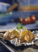 Steaming baked potato with roast beef & quark filling