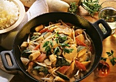 Mixed vegetables with Thai curry sauce in a wok