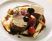 Loin of venison with cep crust on vegetable puree, wine sauce