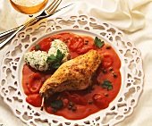 Rabbit leg with mustard crust on caper and tomato sauce