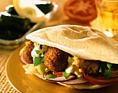 Falafel sandwich (chick-pea balls and vegetables in bread)