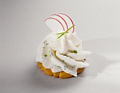 A Cracker Topped with Cream Cheese and Chives