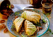 Chinese cabbage roulades with tofu and pecan nuts