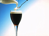 Pouring Cream into and Irish Coffee