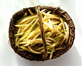 Yellow wax beans in wicker basket