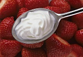 Cut Strawberries with a Spoonful of Cream