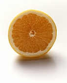 A halved yellow grapefruit on white background