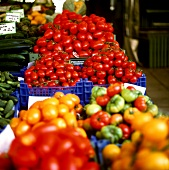 Peppers and tomatoes on a market stall
