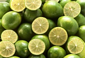 Limes and lime halves (filling the picture)