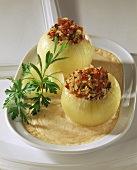 Stuffed onions with rice & pepper stuffing & cheese sauce