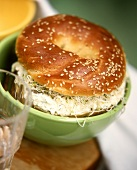 Sesame bagel with horseradish & cream cheese spread & sprouts