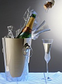 Champagne in champagne bucket & glass, champagne corks