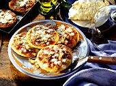 Mini-pizzas with tomatoes, mushrooms and cheese