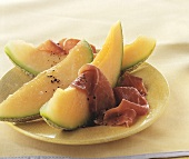 Slice of melon with ham and pepper