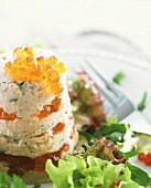 Smoked salmon timbale with caviare on lettuce