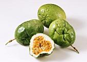 Several green passion fruits (granadilla)