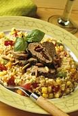 Sliced lamb fillet on bulgur with vegetables