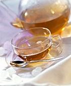 Tea in Glass Cup; Pot