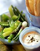 Steamed green vegetables, tuna sauce beside them
