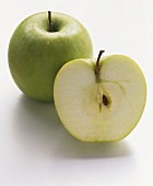 Half and whole Granny Smith apple