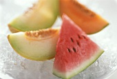 Various melon slices on crushed ice
