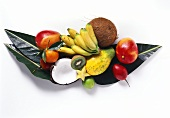 Exotic fruits and coconut on banana leaves