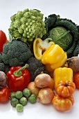 Still life with fresh vegetables on white background